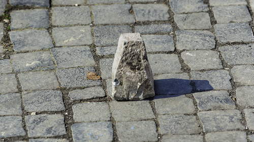 Typical pavement of the streets of Rome with cobblestone (sanpietrini). In view of one of the stone slopes